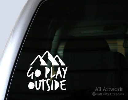Go Play Outside decal in White (shown on truck window)