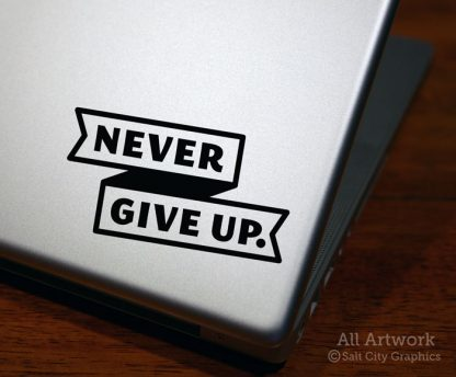 Never Give Up. Decal in Black (shown on laptop)
