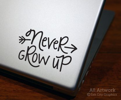 Never Grow Up Decal in Black (shown on laptop)