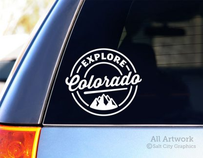 Explore Colorado Decal (with Mountains) in White (shown on SUV window)