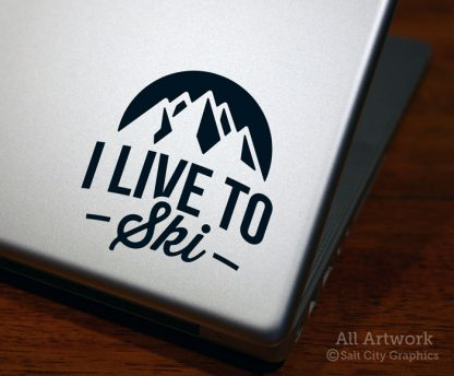 I Live to Ski Decal in Black (shown on laptop)